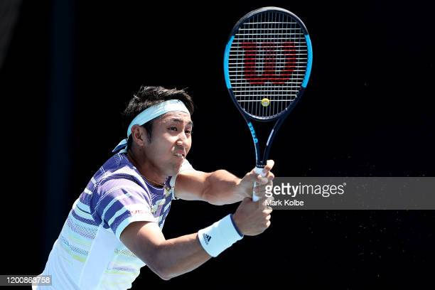 Yasutaka Uchiyama of Japan plays a backhand during his Men's Singles first round match against Mikael Ymer of Sweden on day two of the 2020...