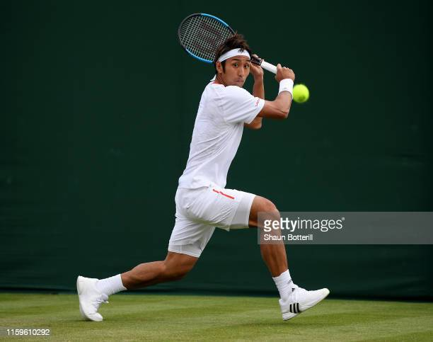 Yasutaka Uchiyama of Japan plays a backhand in his Men's Singles first round match against Tennys Sandgren of The United States during Day two of The...