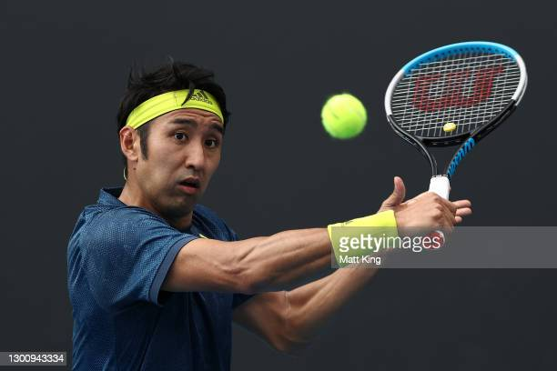 Yasutaka Uchiyama of Japan plays a backhand in his Men's Singles first round match against Ugo Humbert of France during day one of the 2021...