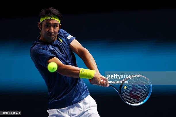 Yasutaka Uchiyama of Japan plays a backhand in his Men's Singles first round match against Marc Polmans of Australia on day two of the Singapore...
