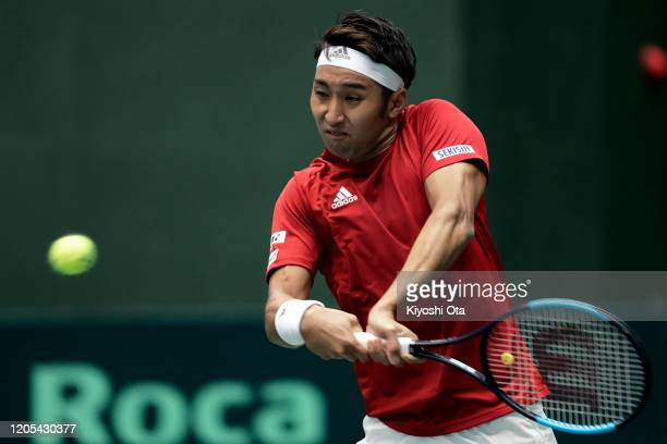 Yasutaka Uchiyama of Japan plays a backhand in his singles match against Roberto Quiroz of Ecuador on day one of the Davis Cup qualifier between...