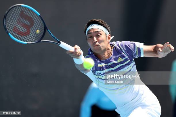 Yasutaka Uchiyama of Japan plays a forehand during his Men's Singles first round match against Mikael Ymer of Sweden on day two of the 2020...