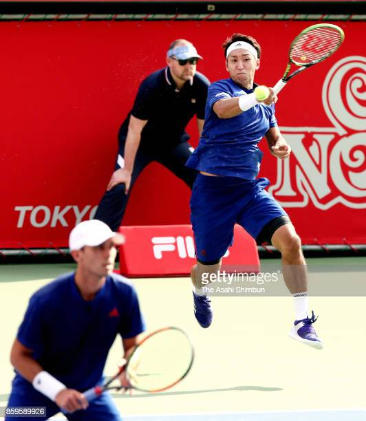 Yasutaka Uchiyama of Japan plays a forehand during their men's doubles final match against Jamie Murray of Great Britain and Bruno Soares of Brazil...