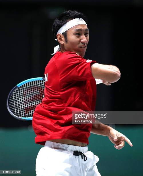 Yasutaka Uchiyama of Japan plays a forehand in his match against JoWilfried Tsonga of France during Day two of the 2019 Davis Cup at La Caja Magica...