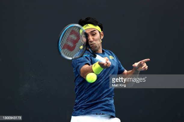 Yasutaka Uchiyama of Japan plays a forehand in his Men's Singles first round match against Ugo Humbert of France during day one of the 2021...