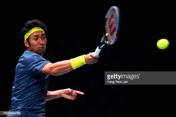 Yasutaka Uchiyama of Japan plays a forehand in his Men's Singles first round match against Marc Polmans of Australia on day two of the Singapore...
