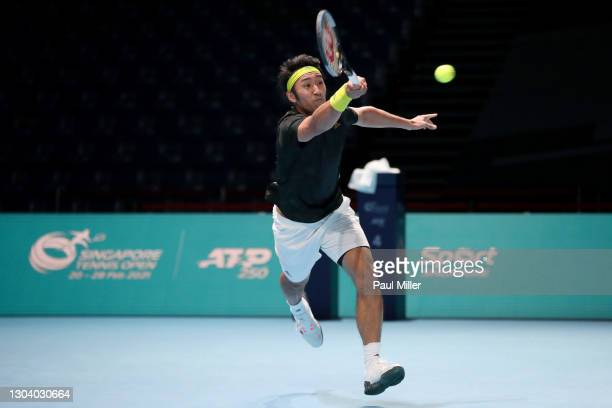 Yasutaka Uchiyama of Japan plays a forehand in his Men's Singles second round match against Soonwoo Kwon of South Korea on day four of the Singapore...