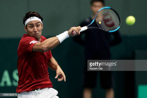Yasutaka Uchiyama of Japan plays a forehand in his singles match against Roberto Quiroz of Ecuador on day one of the Davis Cup qualifier between...