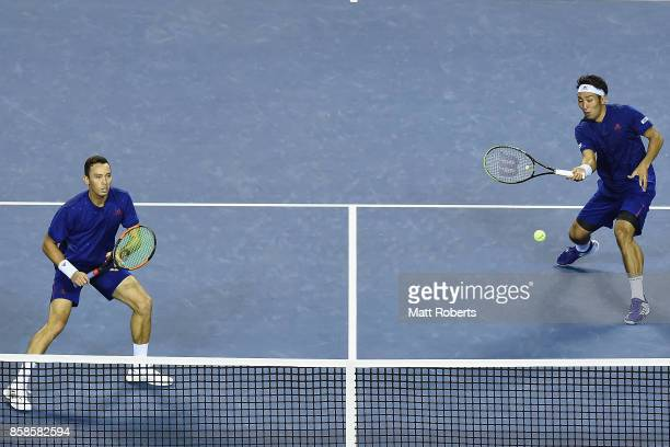 Yasutaka Uchiyama of Japan plays a forehand with doubles partner Ben McLachlan of Japan in their men's doubles semi final match against Santiago...