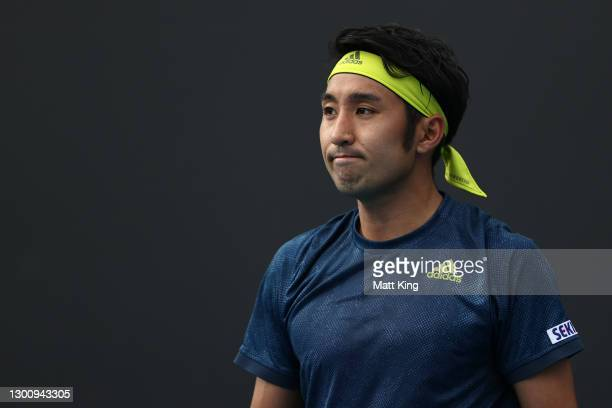 Yasutaka Uchiyama of Japan reacts in his Men's Singles first round match against Ugo Humbert of France during day one of the 2021 Australian Open at...