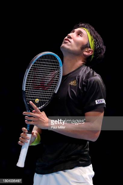 Yasutaka Uchiyama of Japan reacts in his Men's Singles second round match against Soonwoo Kwon of South Korea on day four of the Singapore Tennis...