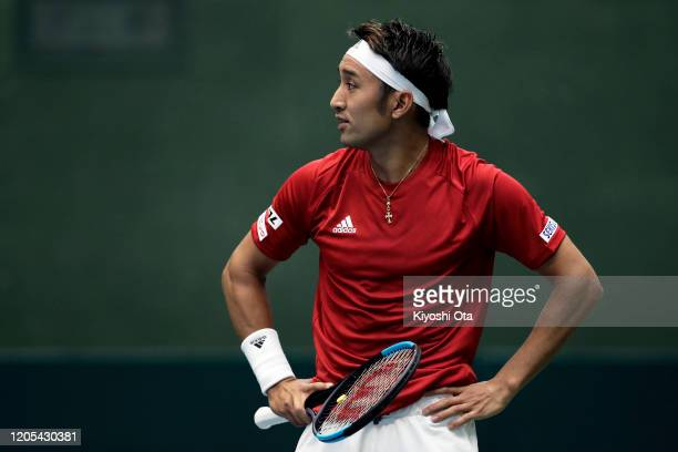 Yasutaka Uchiyama of Japan reacts while playing in his singles match against Roberto Quiroz of Ecuador on day one of the Davis Cup qualifier between...