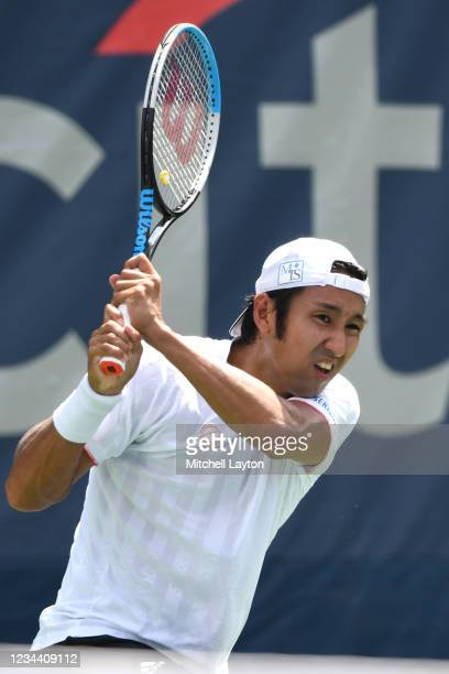 Yasutaka Uchiyama of Japan returns a shot during a match against Andreas Seppi of Italy on Day 3 during the Citi Open at Rock Creek Tennis Center on...