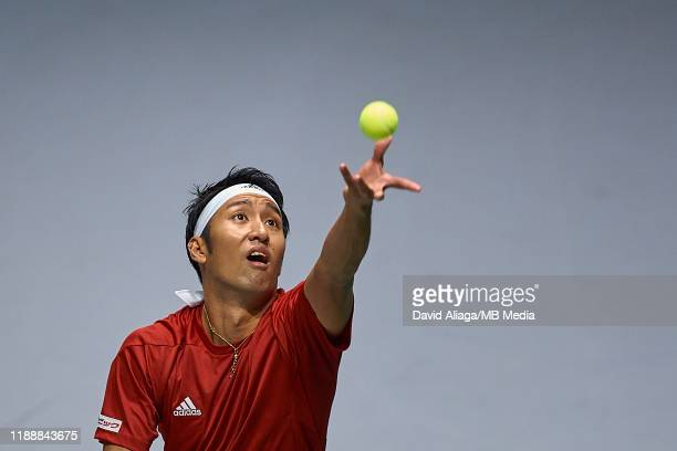 Yasutaka Uchiyama of Japan serves during his match against JoWilfried Tsonga of France during Day two of the 2019 Davis Cup at La Caja Magica on...