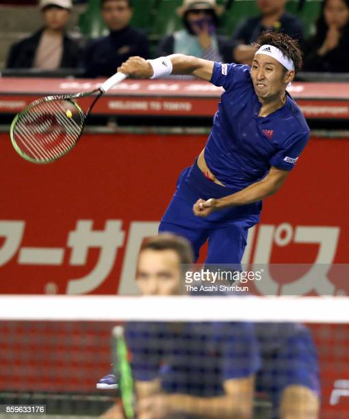 Yasutaka Uchiyama of Japan serves during their men's doubles semi final match against Santiago Gonzalez of Mexico and Julio Peralta of Chile during...