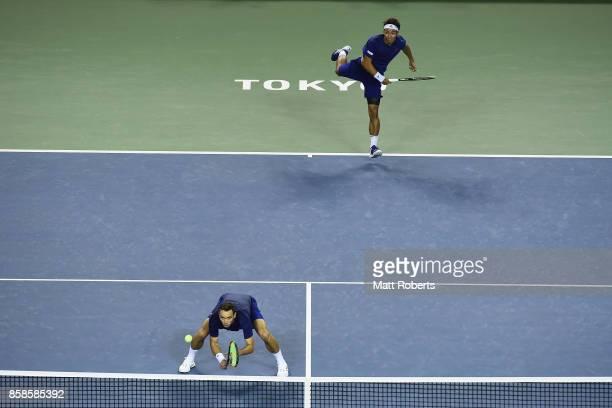 Yasutaka Uchiyama of Japan serves with doubles partner Ben McLachlan of Japan in their men's doubles semi final match against Santiago Gonzalez of...