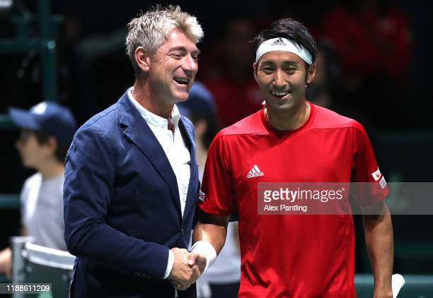 Yasutaka Uchiyama of Japan shakes hands with the Referee before his match against Jo-Wilfried Tsonga of France during Day two of the 2019 Davis Cup...