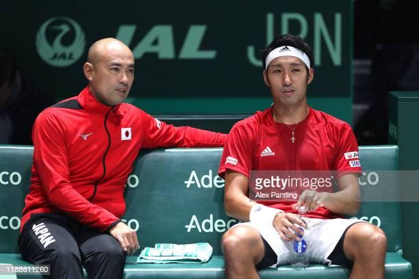 Yasutaka Uchiyama of Japan speaks with Satoshi Iwabuchi Captain of Japan in his match against JoWilfried Tsonga of France during Day two of the 2019...