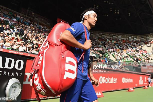 Yasutaka Uchiyama of Japan walks onto the court with doubles partner Ben McLachlan of Japan in their men's doubles final match against Jamie Murray...