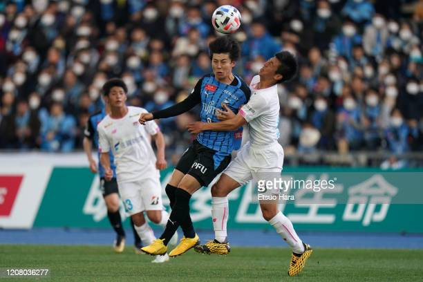 Yasuto Wakizaka of Kawasaki Frontale and Daiki Matsuoka of Sagan Tosu compete for the ball during the JLeague MEIJI YASUDA J1 match between Kawasaki...