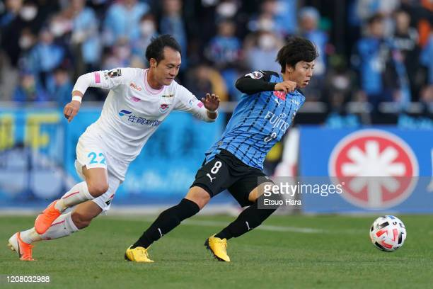 Yasuto Wakizaka of Kawasaki Frontale and Tomoya Koyamatsu of Sagan Tosu compete for the ball during the JLeague MEIJI YASUDA J1 match between...