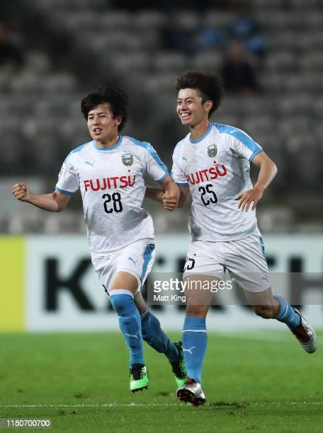 Yasuto Wakizaka of Kawasaki Frontale celebrates with Ao Tanaka after scoring a goal during the AFC Asian Champions League match between Sydney FC and...