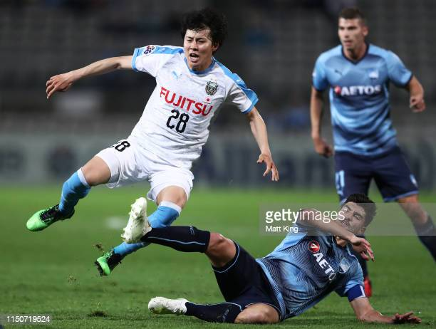 Yasuto Wakizaka of Kawasaki Frontale is tackled by Paulo Retre of Sydney FC during the AFC Asian Champions League match between Sydney FC and...