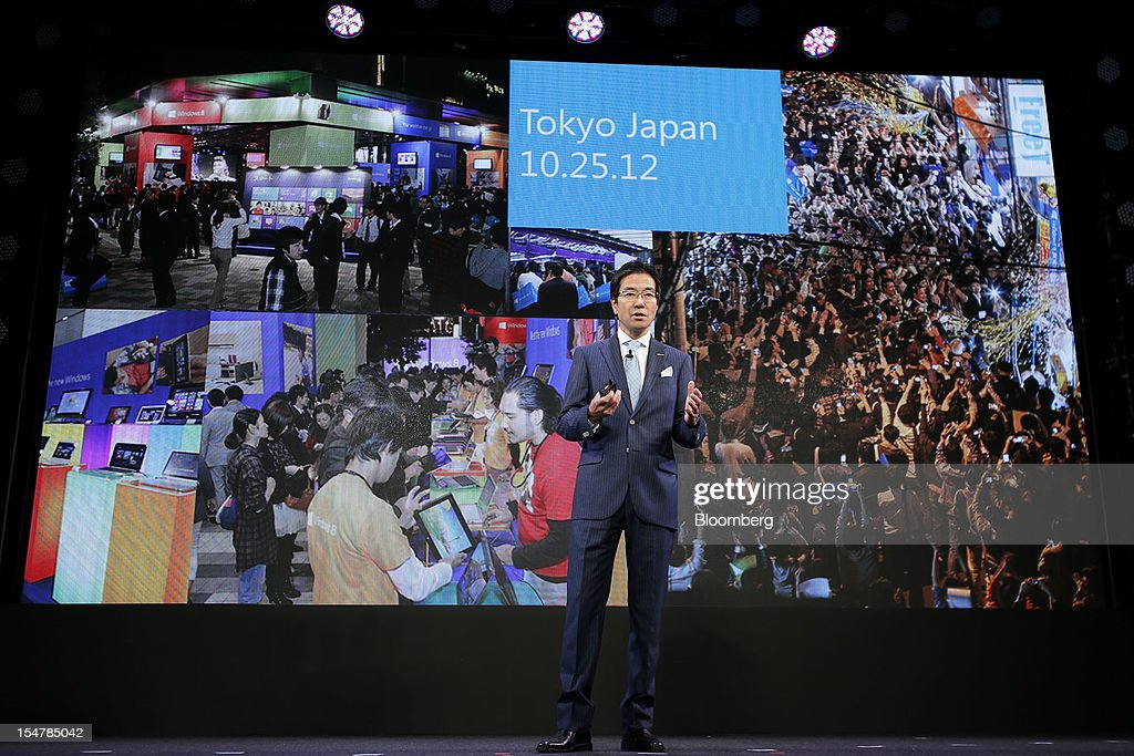 Yasuyuki Higuchi, president and chief executive officer of Microsoft Japan Co., speaks during a launch event for Microsoft Corp.'s Windows 8 operating system in Tokyo, Japan, on Friday, Oct. 26, 2012. Microsoft introduced the biggest overhaul of its flagship Windows software in two decades, reflecting the rising stakes in its competition with Apple Inc. and Google Inc. for the loyalty of customers who are shunning personal computers and flocking to mobile devices. Photographer: Kiyoshi Ota/Bloomberg via Getty Images