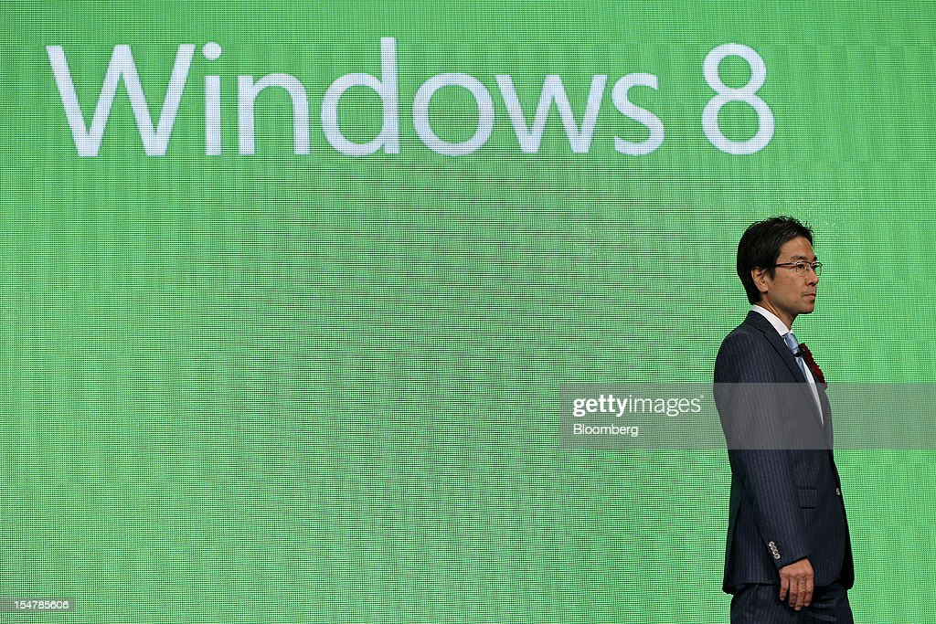 Yasuyuki Higuchi, president and chief executive officer of Microsoft Japan Co., attends a launch event for Microsoft Corp.'s Windows 8 operating system in Tokyo, Japan, on Friday, Oct. 26, 2012. Microsoft introduced the biggest overhaul of its flagship Windows software in two decades, reflecting the rising stakes in its competition with Apple Inc. and Google Inc. for the loyalty of customers who are shunning personal computers and flocking to mobile devices. Photographer: Kiyoshi Ota/Bloomberg via Getty Images