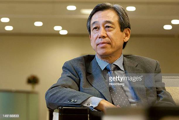 Yasuyuki Kimoto chairman of Olympus Corp poses for a photograph in Tokyo Japan on Monday July 23 2012 Olympus Corp is continuing discussions with...