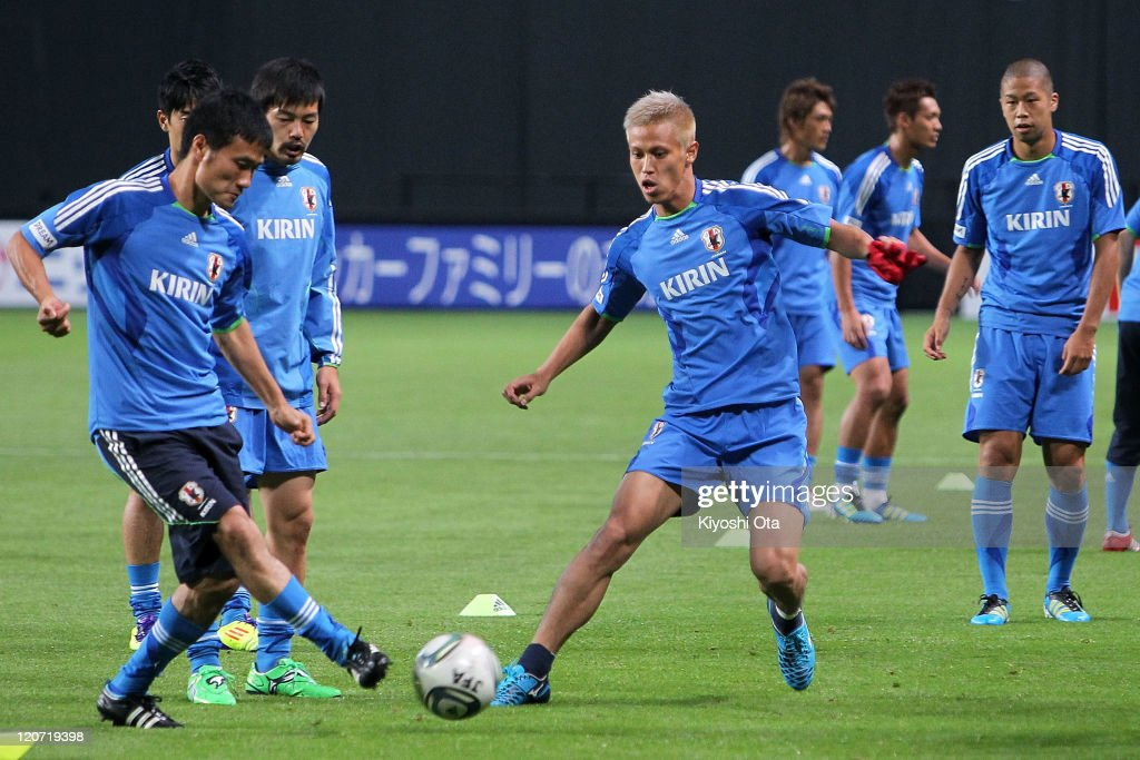 Yasuyuki Konno (L), Daisuke Matsui (2nd L), Keisuke Honda (C) and Takayuki Morimoto (R) take part in the Japan national team training session ahead of the Kirin Challenge Cup international friendly match against South Korea at Sapporo Dome on August 9, 2011 in Sapporo, Japan.