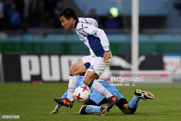 Yasuyuki Konno of Gamba Osaka and Kengo Nakamura of Kawasaki Frontale compete for the ball during the JLeague J1 match between Kawasaki Frontale and...