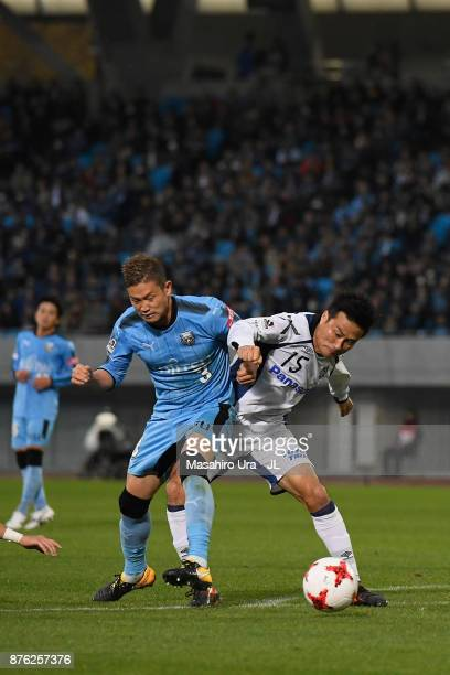 Yasuyuki Konno of Gamba Osaka and Tatsuki Nara of Kawasaki Frontale compete for the ball during the JLeague J1 match between Kawasaki Frontale and...