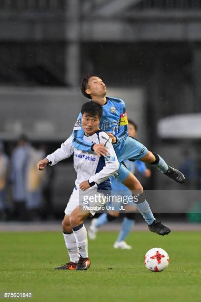 Yasuyuki Konno of Gamba Osaka and Yu Kobayashi of Kawasaki Frontale compete for the ball during the JLeague J1 match between Kawasaki Frontale and...