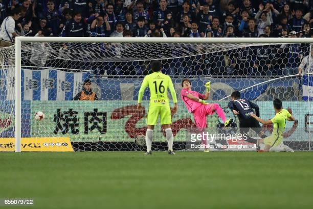 Yasuyuki Konno of Gamba Osaka heads the ball to score the opening goal during the J.League J1 match between Gamba Osaka and Urawa Red Diamonds at...