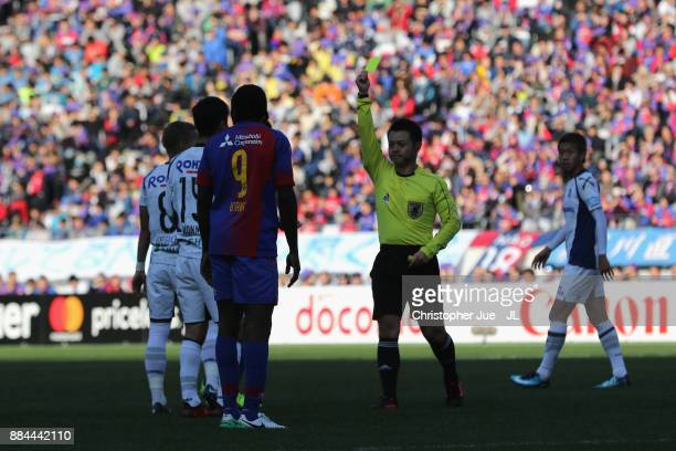 Yasuyuki Konno of Gamba Osaka is shown a yellow card by referee Koichiro Fukushima during the JLeague J1 match between FC Tokyo and Gamba Osaka at...