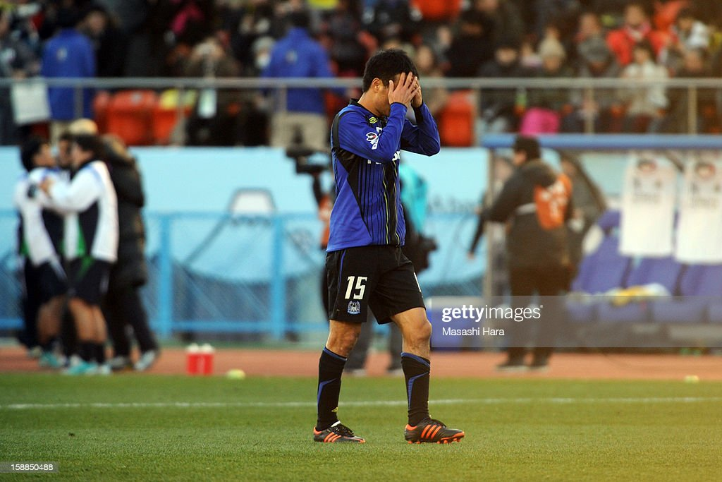 Yasuyuki Konno #15 of Gamba Osaka reacts after the 92nd Emperor's Cup final match between Gamba Osaka and Kashiwa Reysol at the National Stadium on January 1, 2013 in Tokyo, Japan.