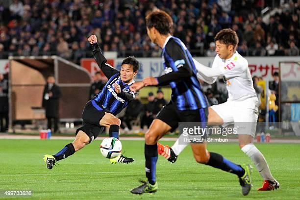 Yasuyuki Konno of Gamba Osaka scores his team's second goal during the JLeague Championship Final frist leg match between Gamba Osaka and Sanfrecce...