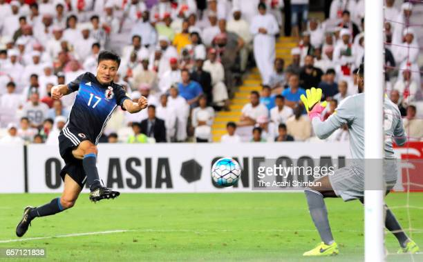 Yasuyuki Konno of Japan scores his side's second goal during the FIFA 2018 World Cup qualifying match between United Arab Emirates and Japan at Hazza...