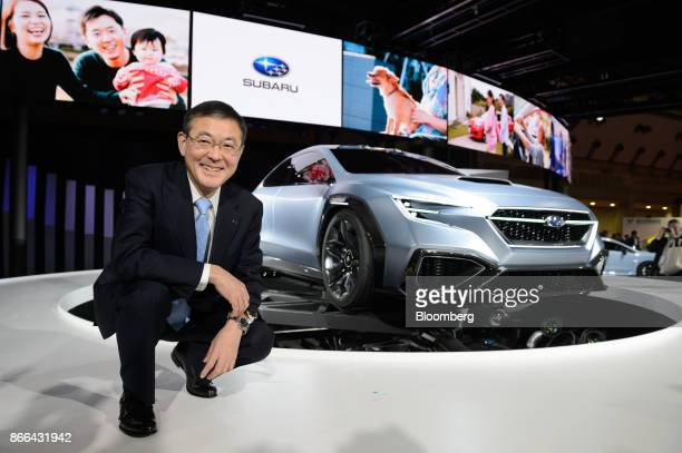 Yasuyuki Yoshinaga president and chief executive officer of Subaru Corp poses for a photograph in front of a Subaru Viziv Performance concept vehicle...