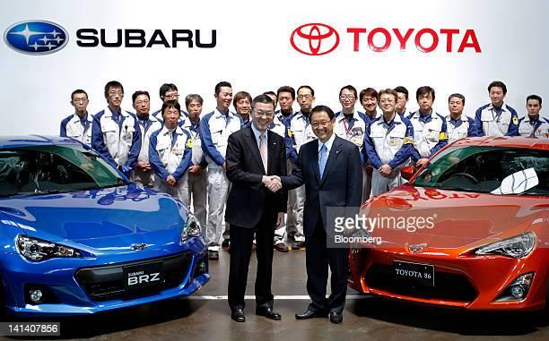 Yasuyuki Yoshinaga president of Fuji Heavy Industries Ltd front left and Akio Toyoda president of Toyota Motor Corp shake hands as they pose for a...