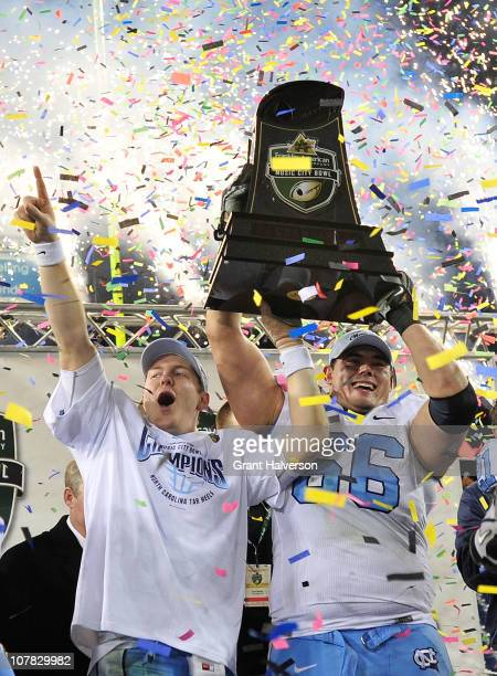 Yates and Mike Ingersoll of the North Carolina Tar Heels of the Tennessee Volunteers during the Franklin American Mortgage Music City Bowl at LP...