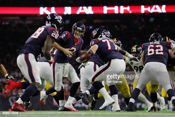 Yates of the Houston Texans hands the ball to Alfred Blue in the third quarter against the Pittsburgh Steelers at NRG Stadium on December 25, 2017 in...