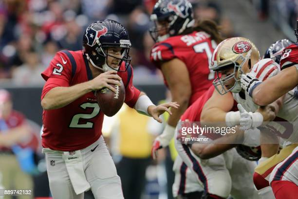 Yates of the Houston Texans is forced out of the pocket by Brock Coyle of the San Francisco 49ers in the third quarter at NRG Stadium on December 10,...