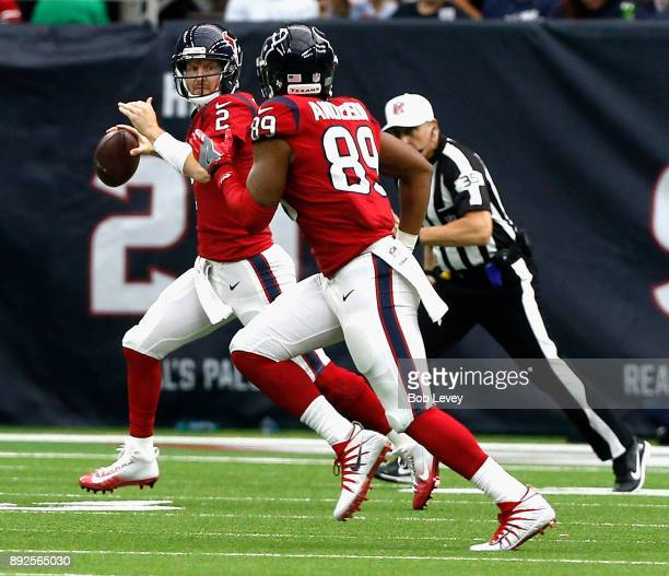 J Yates of the Houston Texans rolls out as he looks at Stephen Anderson at NRG Stadium on December 10 2017 in Houston Texas