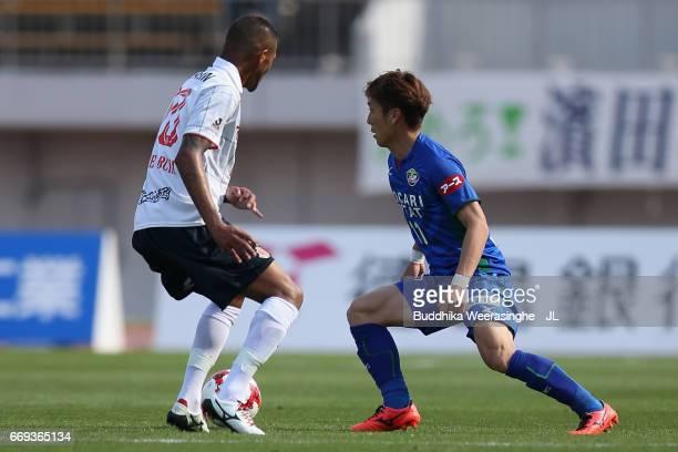 Yatsunori Shimaya of Tokushima Vortis takes on Felipe Garcia of Nagoya Grampus during the JLeague J2 match between Tokushima Vortis and Nagoya...