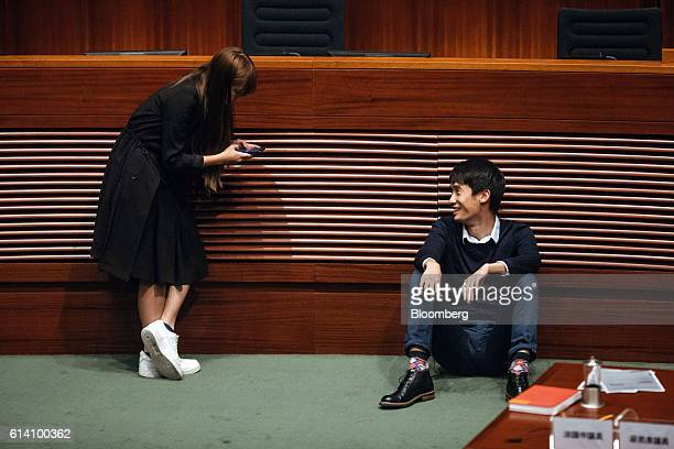 Yau Waiching an incoming lawmaker and member of Youngspiration left speaks with Sixtus 'Baggio' Leung a lawmaker and member of Youngspiration during...