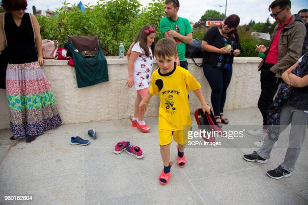 Yavor Milchov and his sister Ranya tried on highheeled shoes during the 'Walk a Mile in Her Shoes' campaign which was held in Sofia to draw attention...