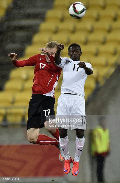 Yaw Yeboah of Ghana competes for the ball with Konrad Laimer of Austria during their FIFA Under20 World Cup football match in Wellington on May 30...