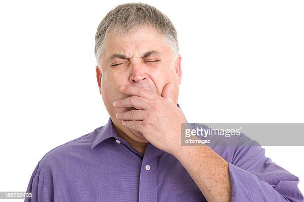 yawning man covers mouth - yawning stock pictures, royalty-free photos & images